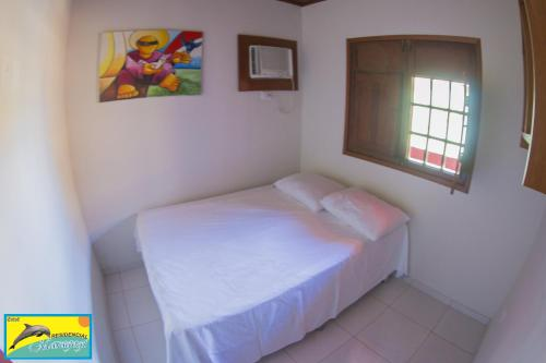 A bed or beds in a room at Residencial Maragogi