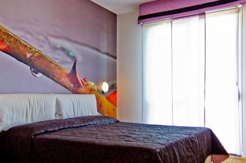 Postel nebo postele na pokoji v ubytování Hotel Oliver