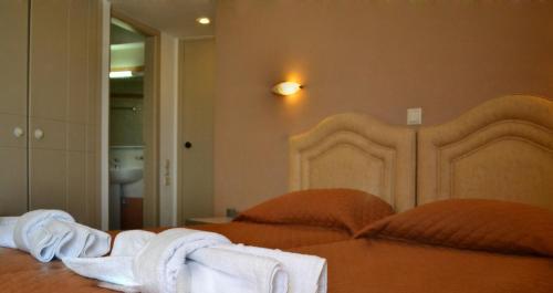Ένα ή περισσότερα κρεβάτια σε δωμάτιο στο Palladion