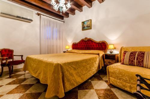 Un ou plusieurs lits dans un hébergement de l'établissement Hotel Ariel Silva