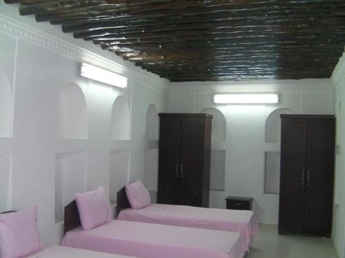 A bed or beds in a room at Sharjah Heritage Youth Hostel
