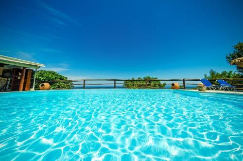 The swimming pool at or near Villa Poseidon