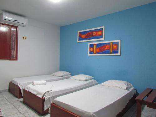 A bed or beds in a room at Pousada Nossa Casa