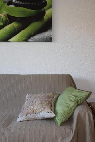 A bed or beds in a room at Sesimbra Flat