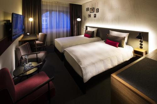 A bed or beds in a room at pentahotel Leuven