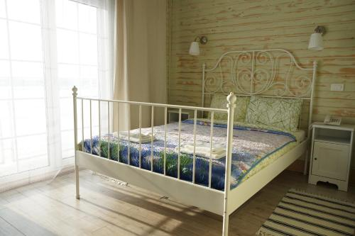 Кровать или кровати в номере Бутик-отель «Островский причал»
