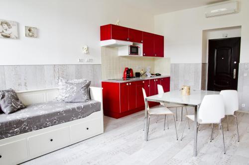 Kuchyň nebo kuchyňský kout v ubytování Royal Court Legerova