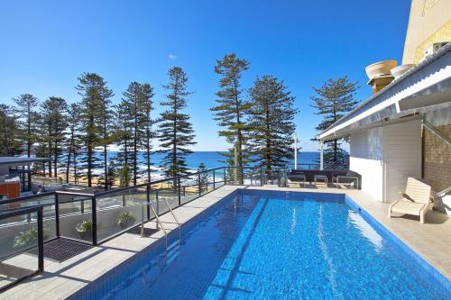 The swimming pool at or near Manly Paradise Motel & Apartments