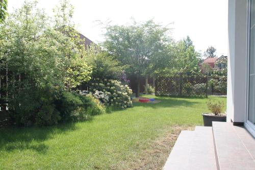 A garden outside Holiday Home Prague Pruhonice