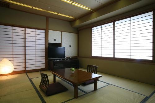 A television and/or entertainment center at King Ambassador Hotel Kumagaya