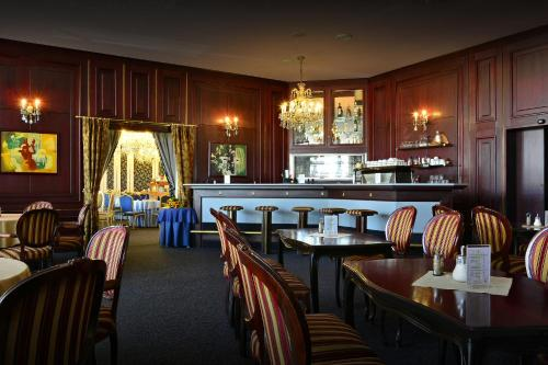 מסעדה או מקום אחר לאכול בו ב-Hotel Olympik
