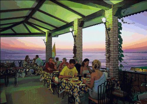 A restaurant or other place to eat at Tropic Hotel