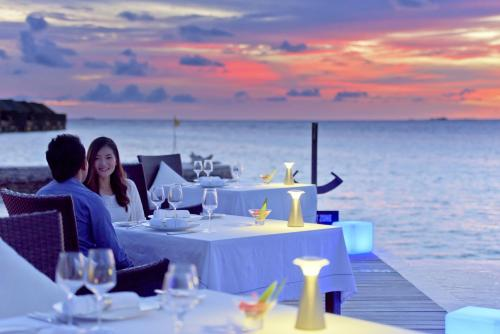 A restaurant or other place to eat at Lily Beach Resort and Spa - All Inclusive