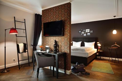 A bed or beds in a room at Syte