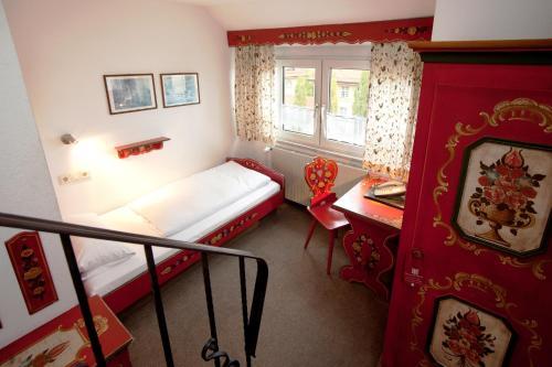 Ein Bett oder Betten in einem Zimmer der Unterkunft Hotel Hahn