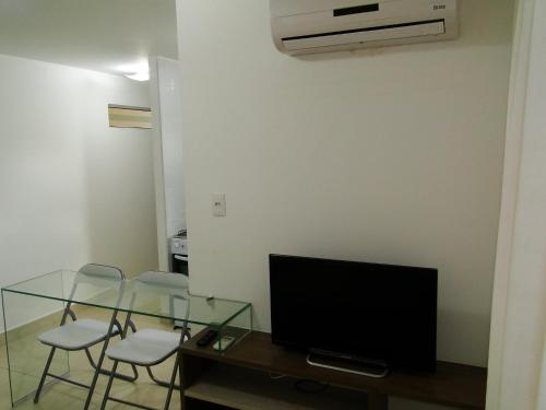 A television and/or entertainment center at Apartment Cabo Branco #4