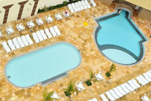 A view of the pool at Via Caldas Exclusive or nearby