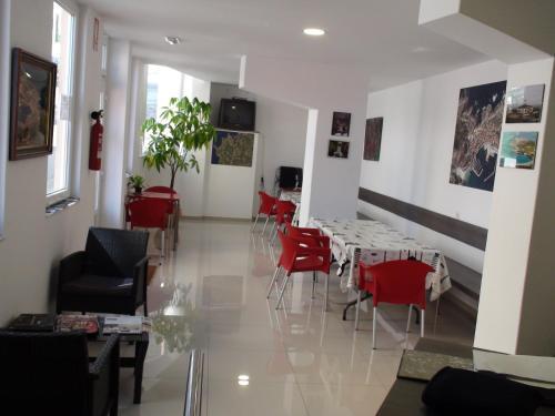 Un restaurante o sitio para comer en Albergue @ Muxia