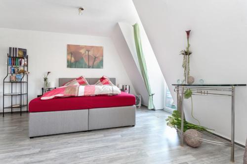 Ein Bett oder Betten in einem Zimmer der Unterkunft Apartment Hechtstraße