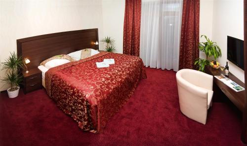 Postel nebo postele na pokoji v ubytování Hotel Princess
