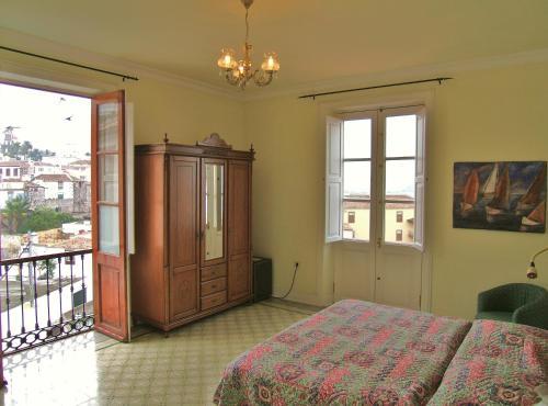 Cama o camas de una habitación en Hotel Alhambra