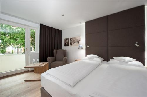 A bed or beds in a room at Sporthotel Reisch