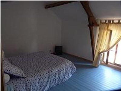 A bed or beds in a room at La Ferme de la Petite Noé