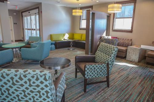 A seating area at Residence Inn by Marriott Decatur Forsyth