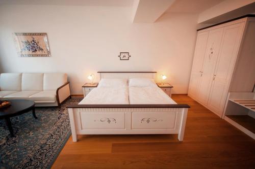 Postel nebo postele na pokoji v ubytování Hotelové Apartmá Černý Jezdec