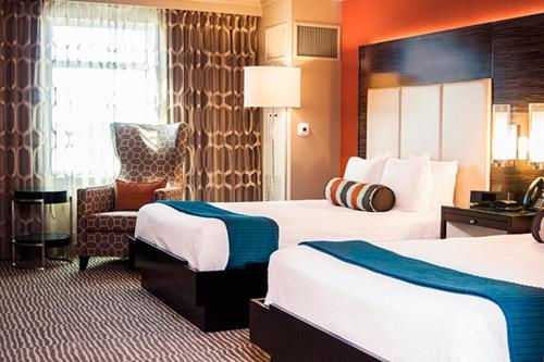 A bed or beds in a room at The Grand Hotel at Coushatta