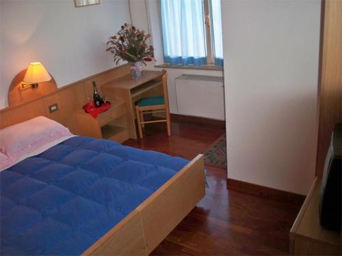 Кровать или кровати в номере Hotel Bar Dany