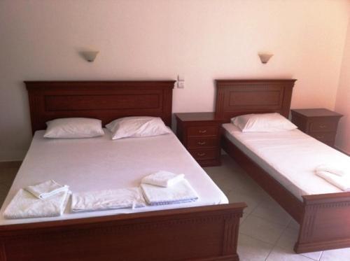 Ένα ή περισσότερα κρεβάτια σε δωμάτιο στο Σιδέρης Λάμπρος Ενοικιαζόμενα Δωμάτια