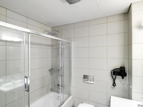 A bathroom at Phidias Piraeus Hotel