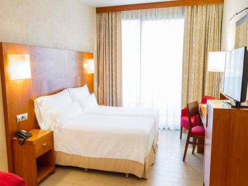 A bed or beds in a room at AR Diamante Beach Spa Hotel