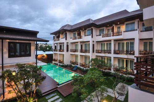 The swimming pool at or near Le Patta Hotel Chiang Rai