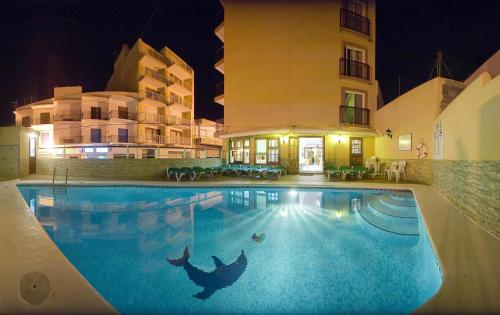 The swimming pool at or near Hostal Adelino