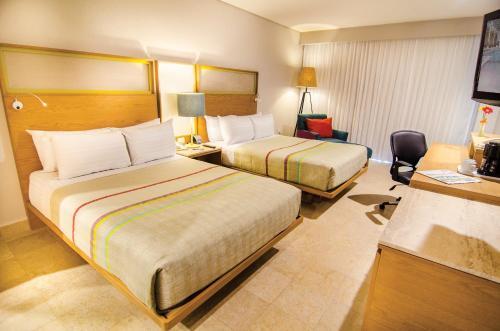 Ein Bett oder Betten in einem Zimmer der Unterkunft Galeria Plaza Veracruz By Brisas
