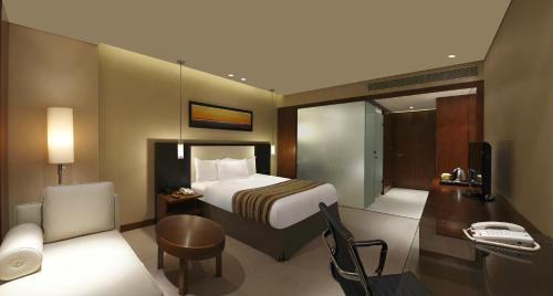 A bed or beds in a room at DoubleTree By Hilton-Pune Chinchwad