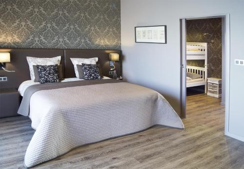 Un ou plusieurs lits dans un hébergement de l'établissement Charmehotel Kruishof