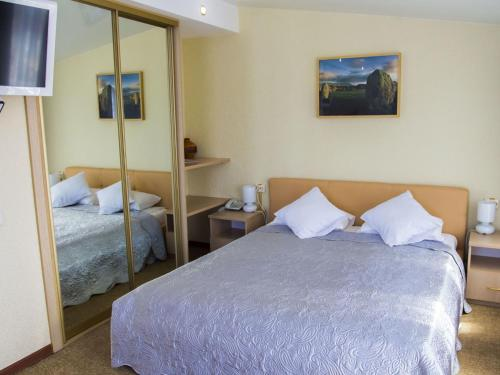 A bed or beds in a room at Silver Key Hotel
