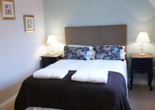 A bed or beds in a room at The Bull at Great Totham Limited