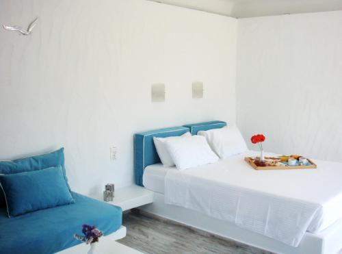 Säng eller sängar i ett rum på Blugreen Stegna B&B (ex Panorama)