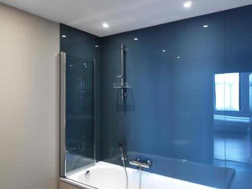 Ванная комната в Hotel La Pomme D'or