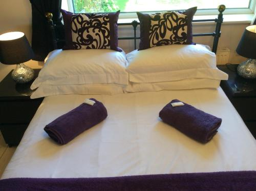 A bed or beds in a room at The Golden Lion Hotel