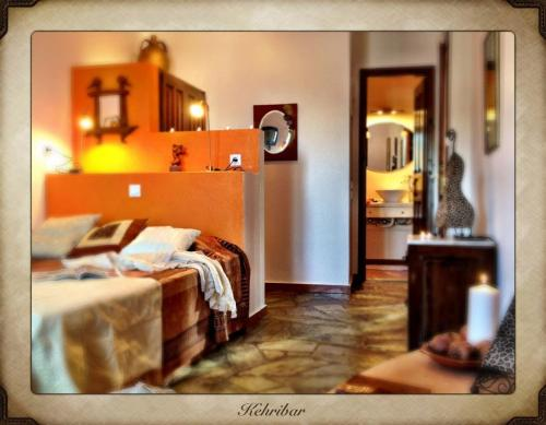 A bed or beds in a room at Aperanto Galazio