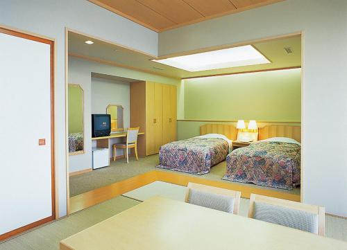 A bed or beds in a room at Noto Omakidai