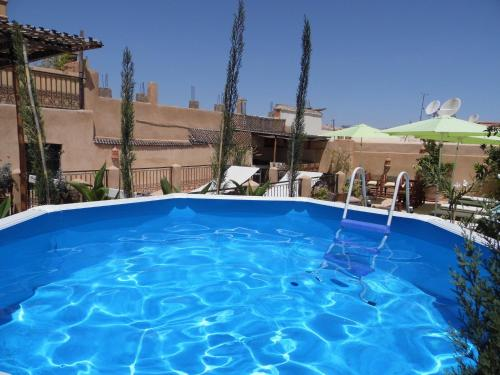 Der Swimmingpool an oder in der Nähe von Riad Signature