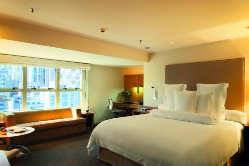 Cama ou camas em um quarto em Hotel Emiliano