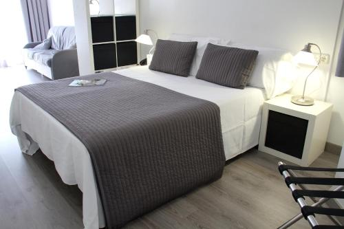 A bed or beds in a room at Aparthotel Atenea Calabria