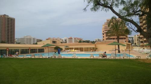 The swimming pool at or near T0 Praia da Rocha